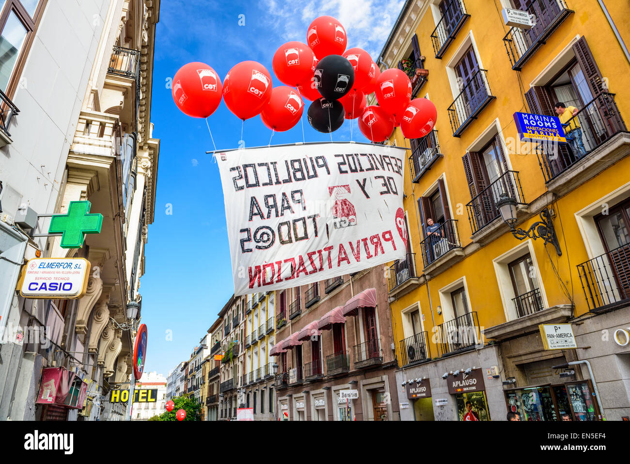 A banner carried by balloons protests the privatization of state-owned airport operator Aena Aeropuertos. - Stock Image
