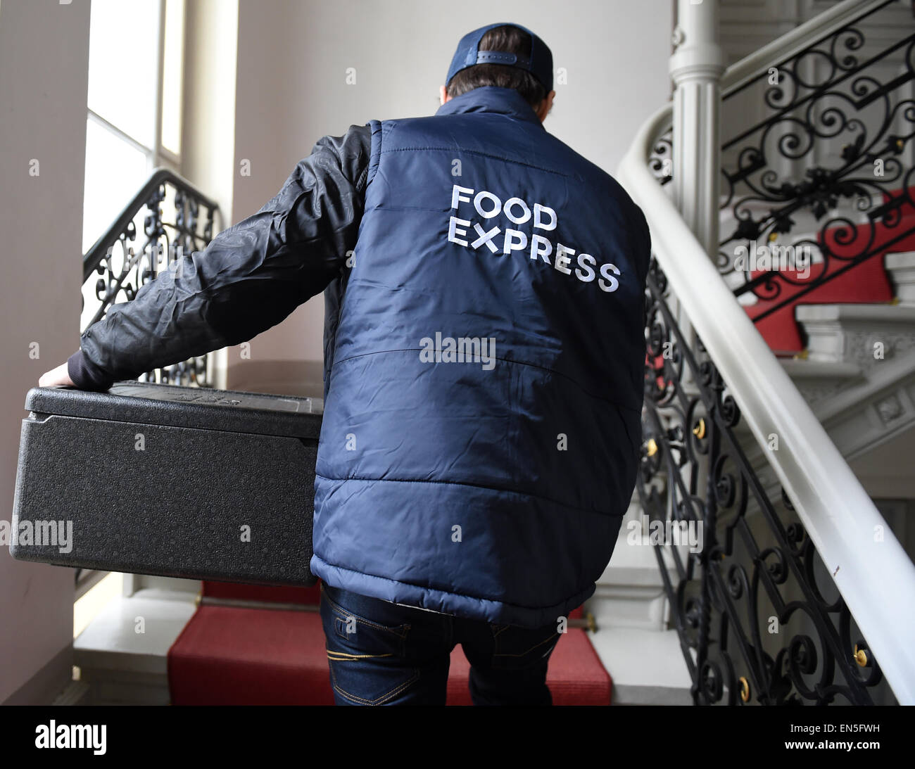 Berlin, Germany. 17th Apr, 2015. ILLUSTRATION - A driver of the independent delivery service 'Food express' - Stock Image