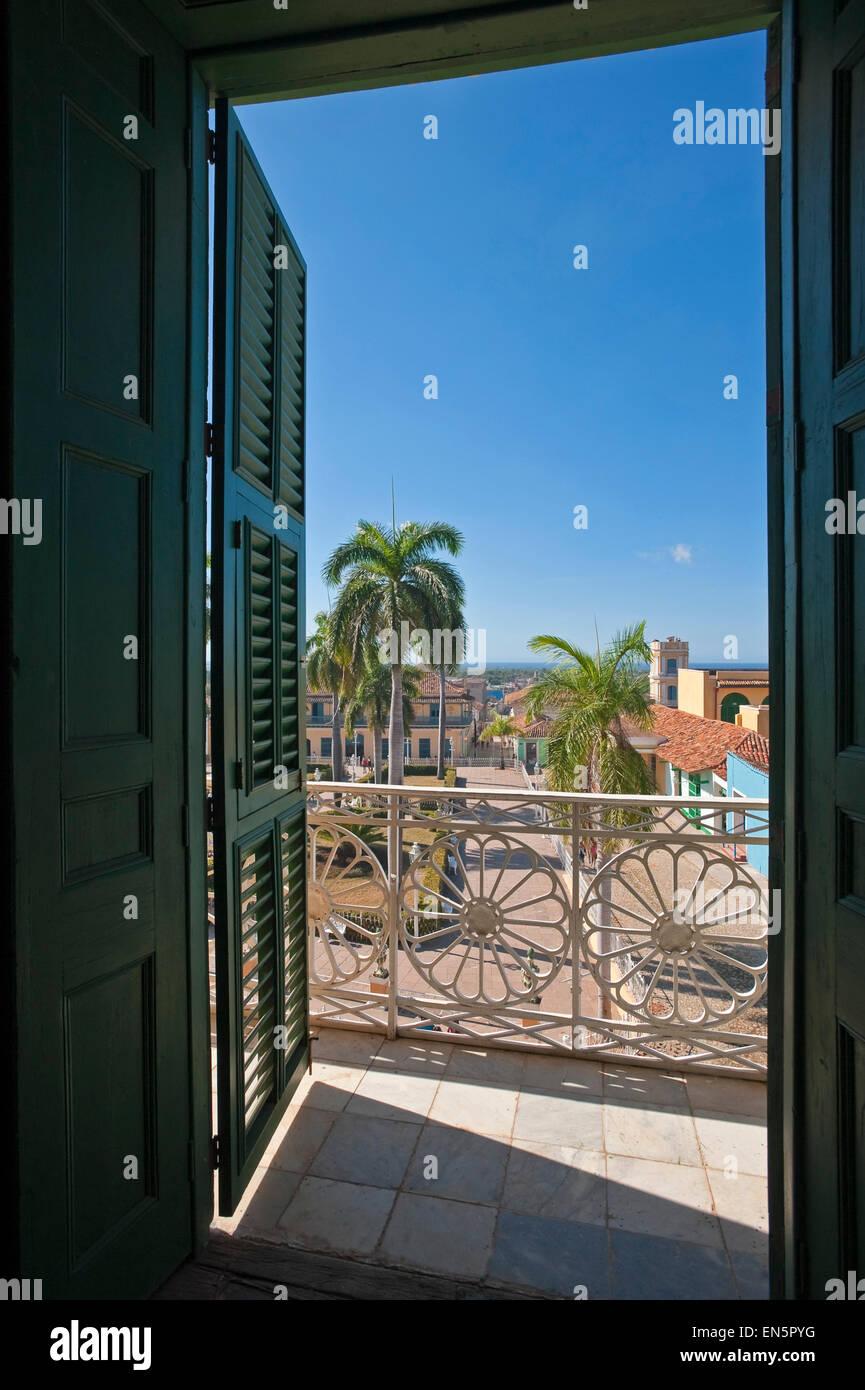 Vertical view through a window of Plaza Mayor in Trinidad, Cuba. Stock Photo