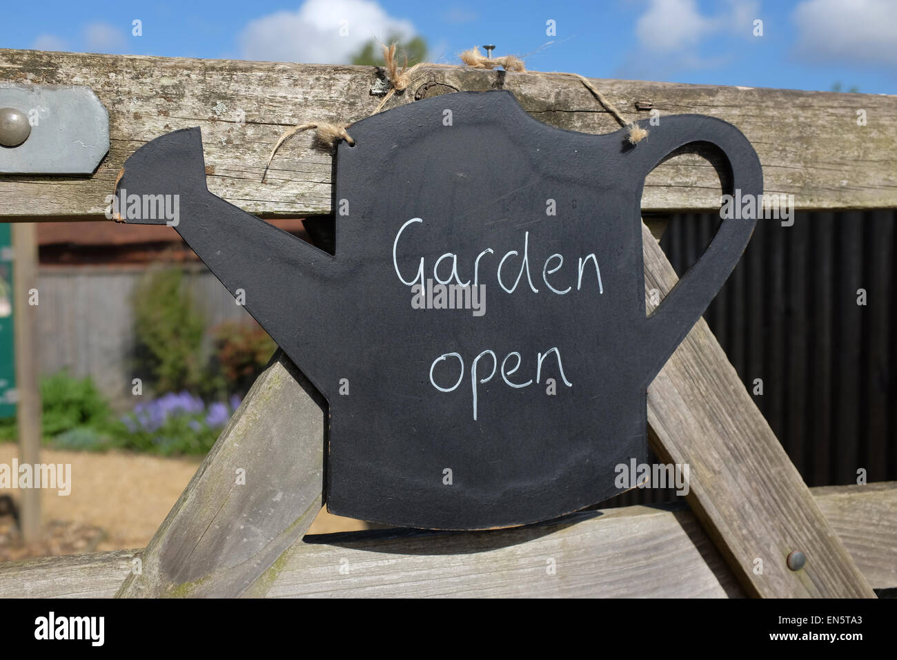 garden open watering can sign on the gate of a garden in Hampshire - Stock Image
