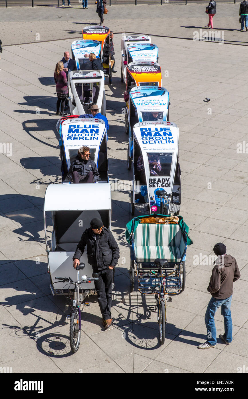 Bicycle Rickshaw drivers wait for customers, for city tour sightseeing, Alexander Square, - Stock Image