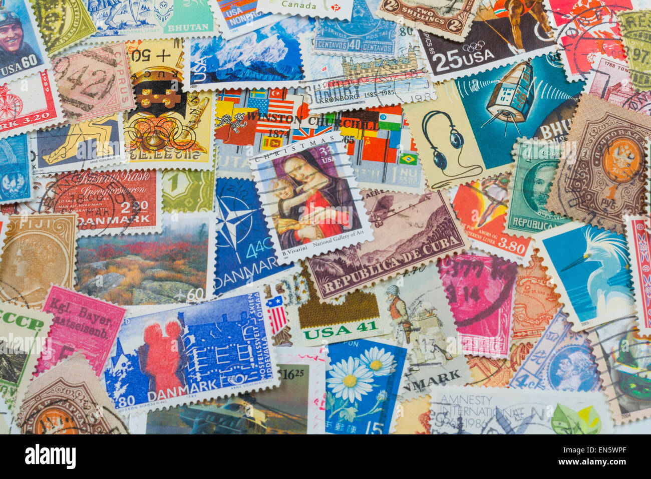 Stamp Collage from postmarked stamps from countries all over the world.  Bright vivid color for background - Stock Image