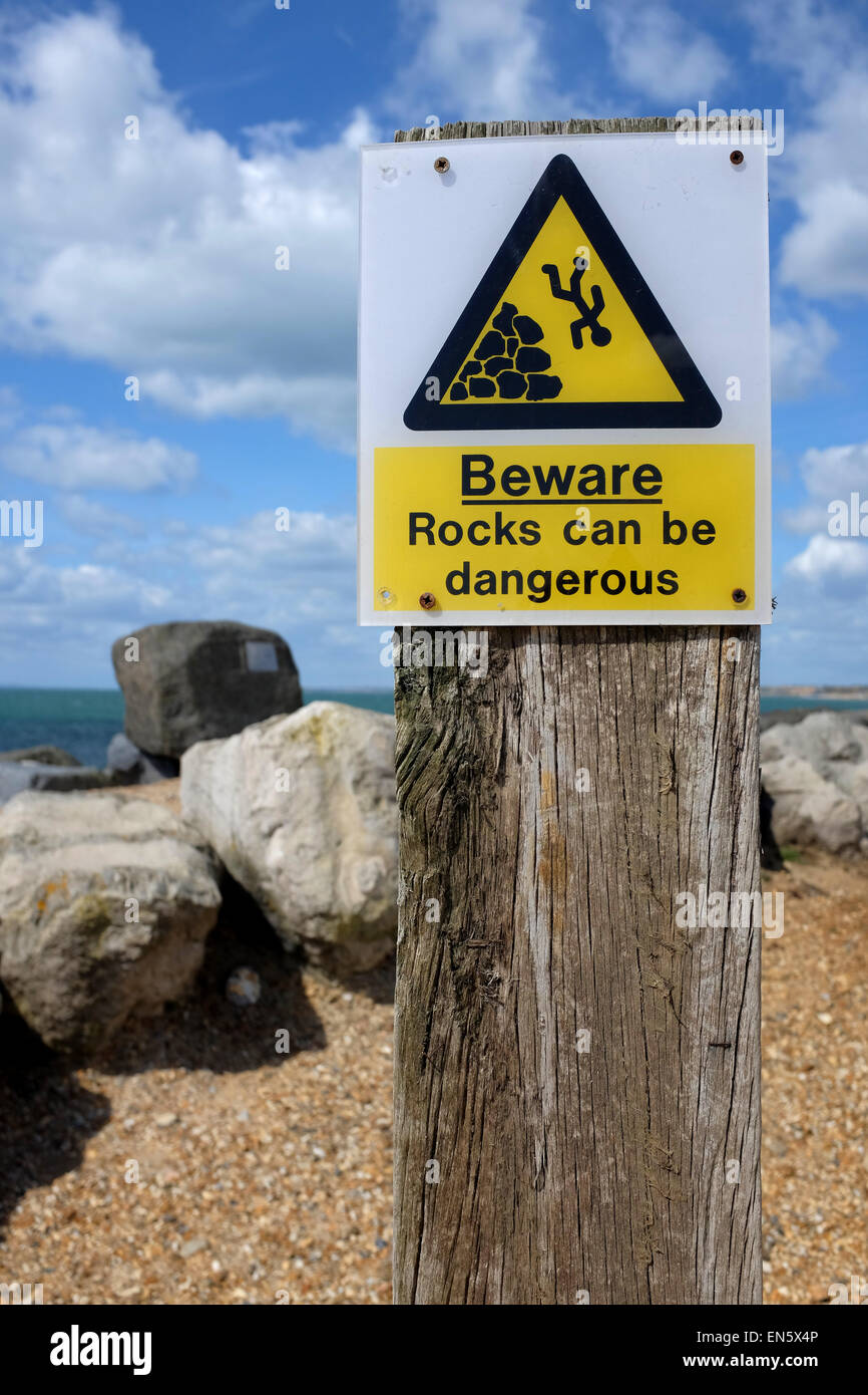Rocks can be dangerous warning sign - Stock Image