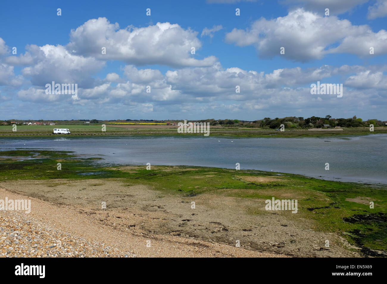 A camper van pictured in a beauty spot in Keyhaven, The New Forest, Hampshire, UK - Stock Image