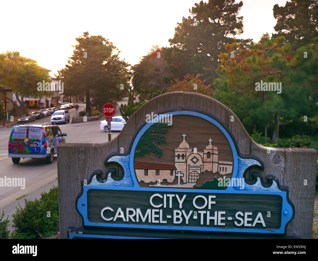 City limits sign with Carmel Mission engraving at entrance to Carmel by the sea California USA - Stock Image