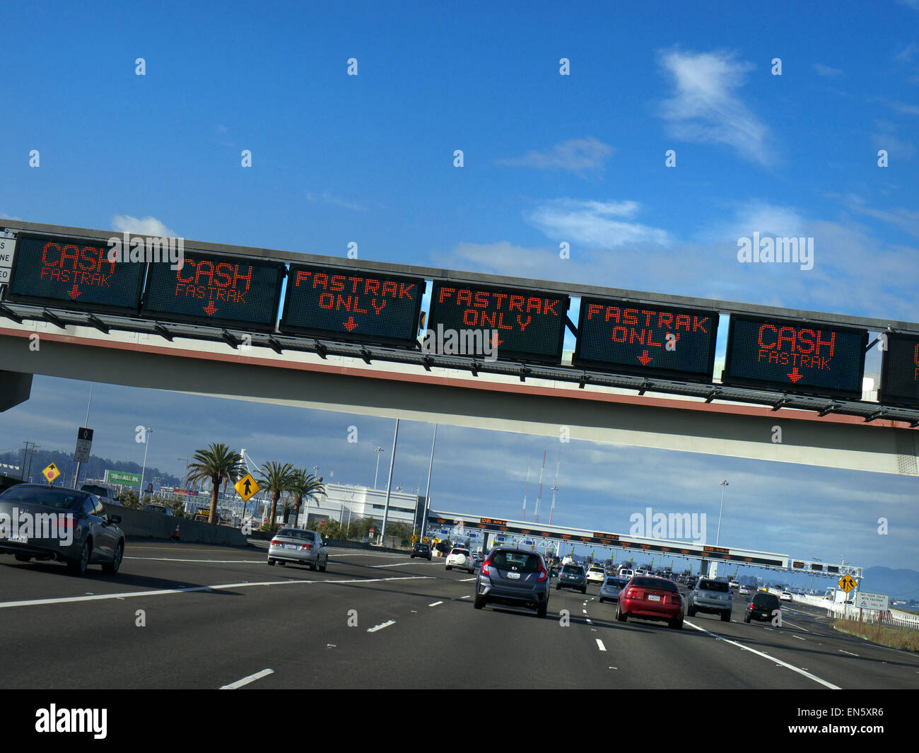 Car POV of Toll Booths and Fastrak signs on gantry over Interstate 80 highway to San Francisco City California USA - Stock Image