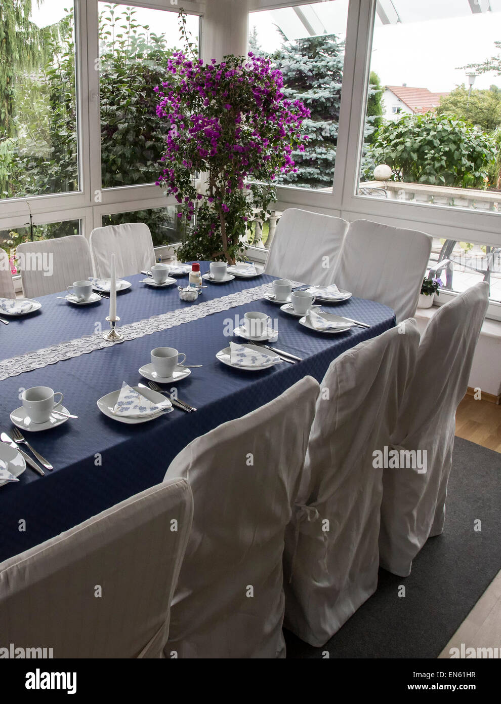 Beautiful family luncheon table in garden room in Germany - Stock Image