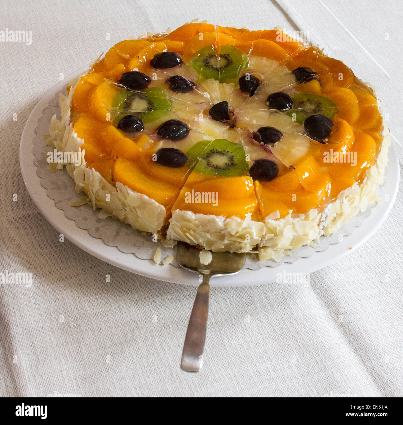 Fruit topped torte at German luncheon - Stock Image