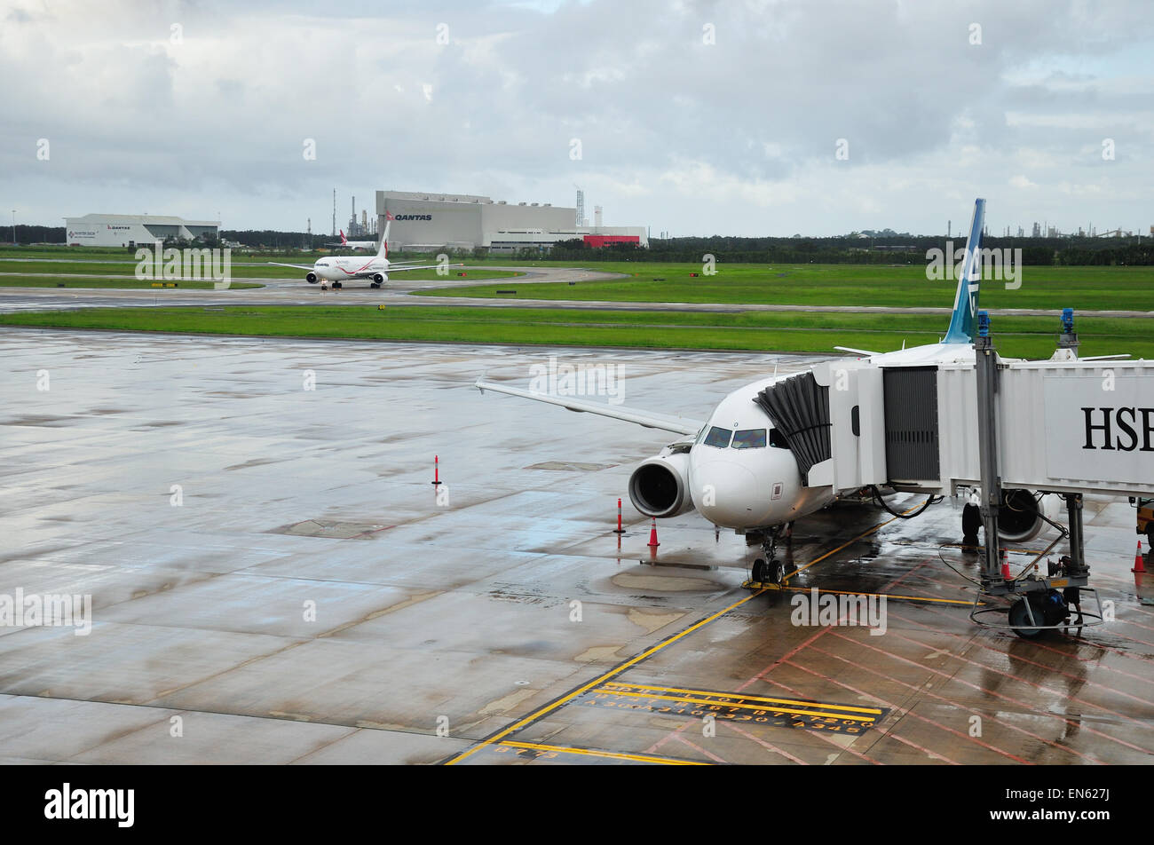 BRISBANE, AUSTRALIA: MARCH 8: commercial airliners on the tarmac on 8-3-2013 at Brisbane International Airport. - Stock Image