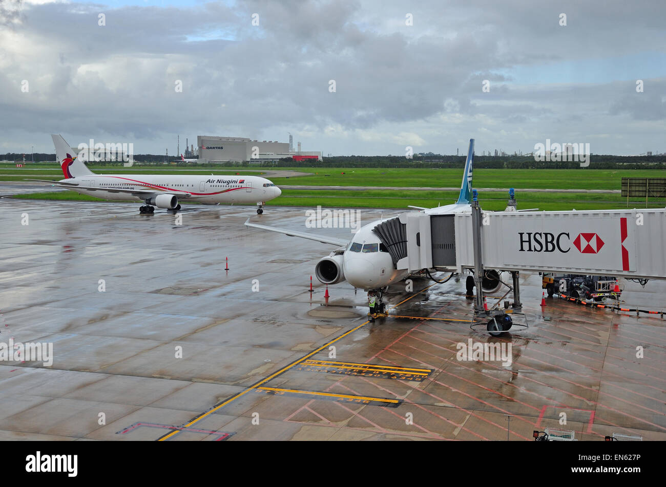 BRISBANE, AUSTRALIA: MARCH 8, 2013: commercial airliners on the tarmac on 8-3-2013 at Brisbane International Airport. - Stock Image