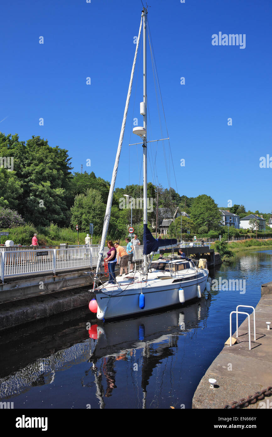 Yacht approaching a lock on the Crinan Canal at Ardrishaig in Argyll, Scotland Stock Photo