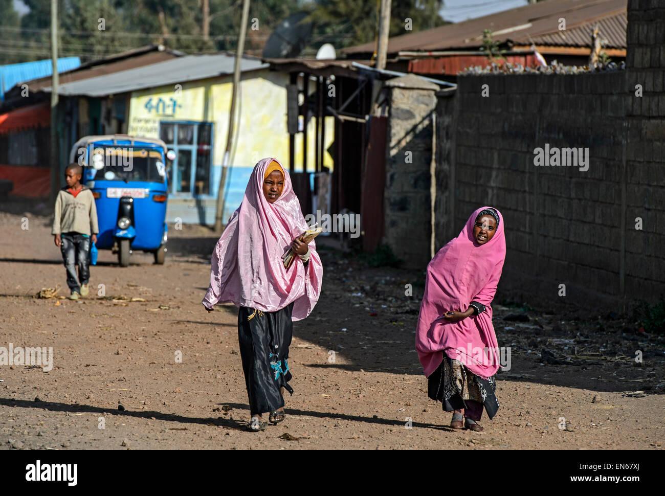 Muslim girls on their way to school in the morning, Goba, Bale area, Oromiya, Ethiopia - Stock Image