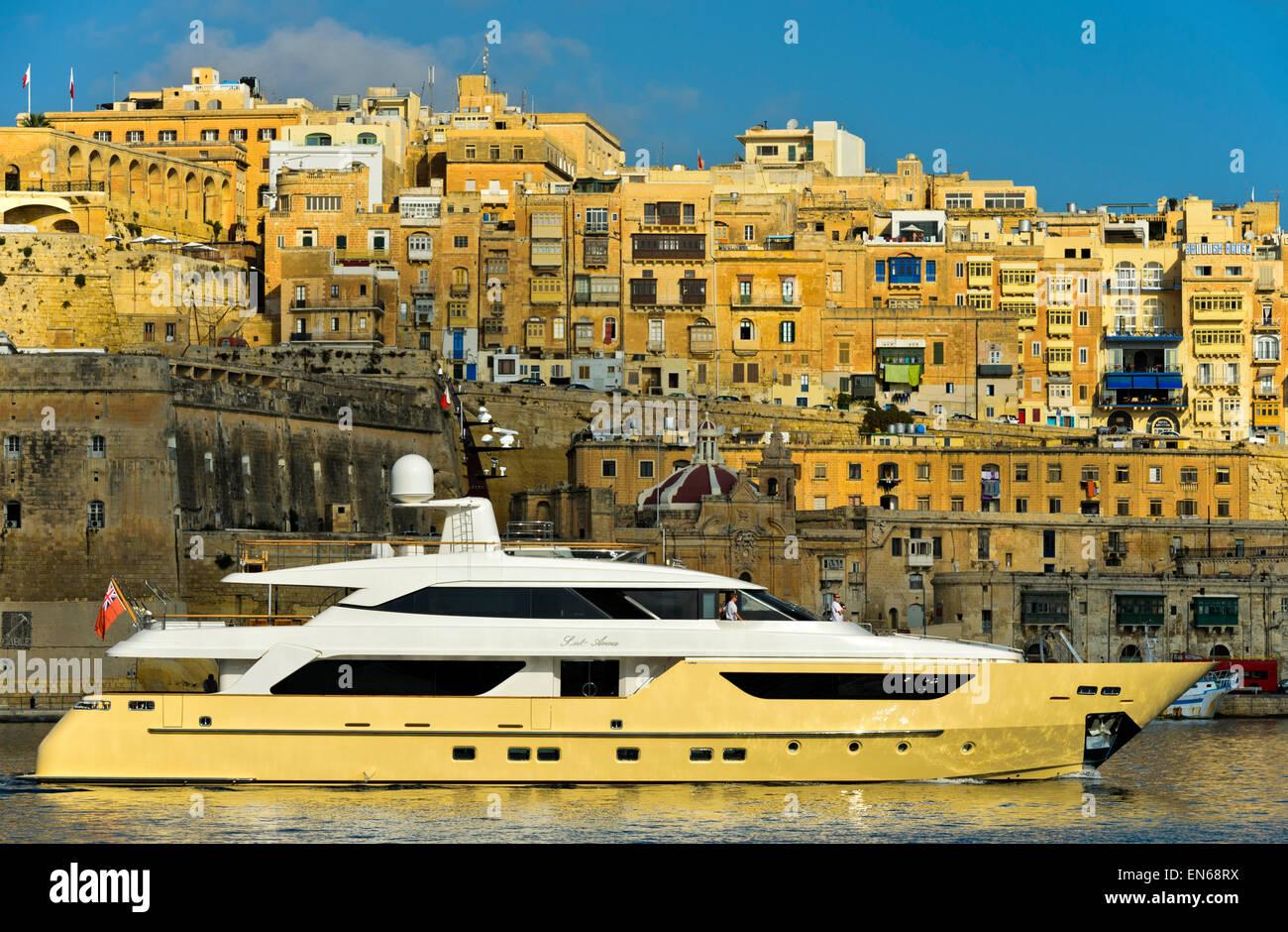 Superyacht Santa Anna in the Grand Harbour area against the scenic background of Valletta, Malta - Stock Image