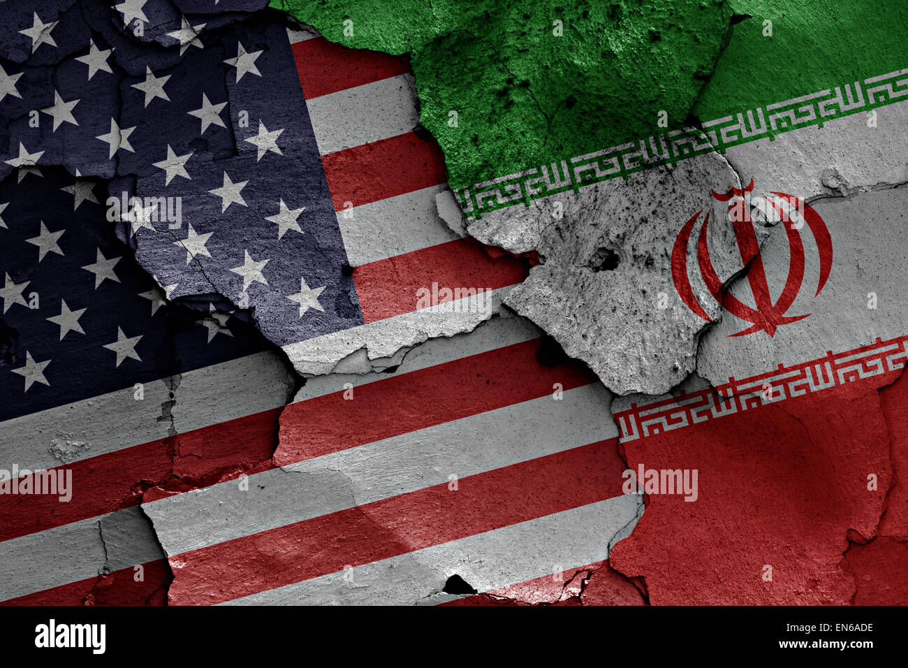 flags of USA and Iran painted on cracked wall - Stock Image