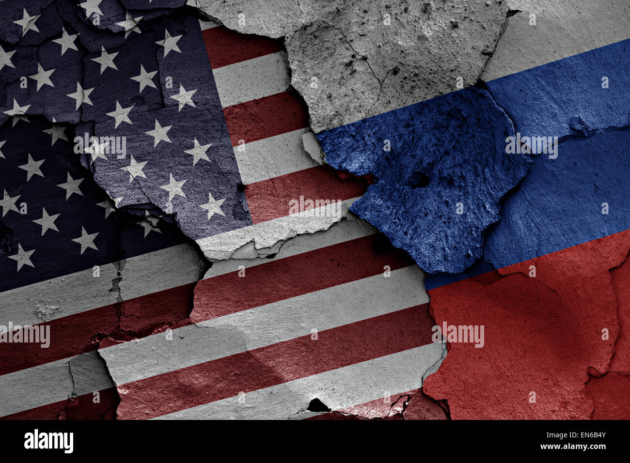 flags of USA and Russia painted on cracked wall - Stock Image