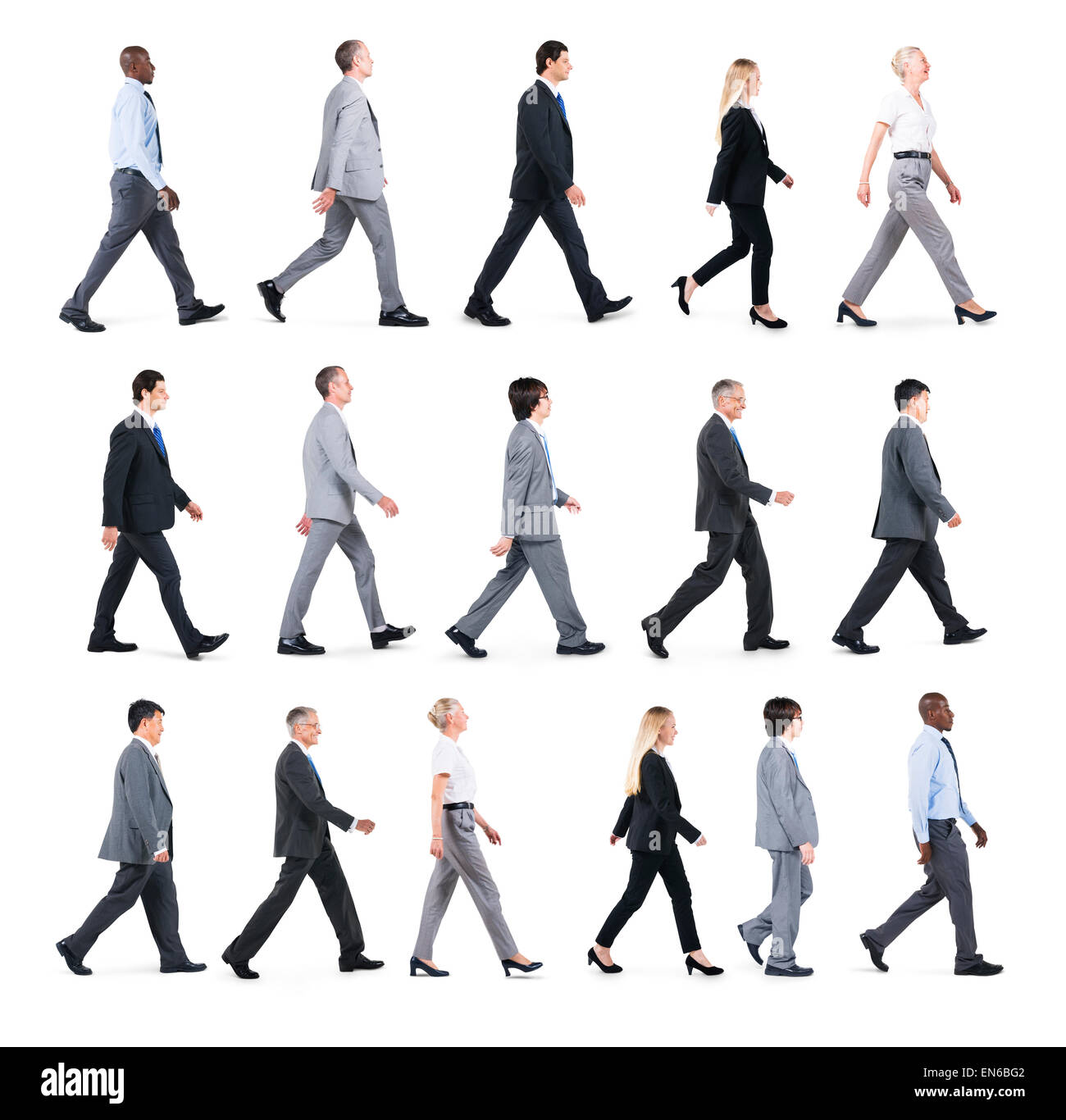 Group of Business People Walking in One Direction - Stock Image