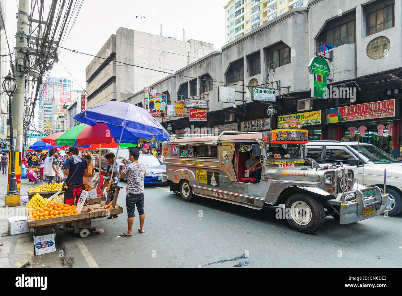 jeepney bus in manila chinatown street in philippines - Stock Image