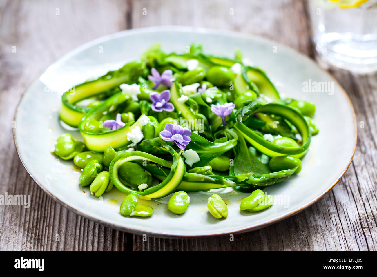 Asparagus, broad beans and lilac salad - Stock Image