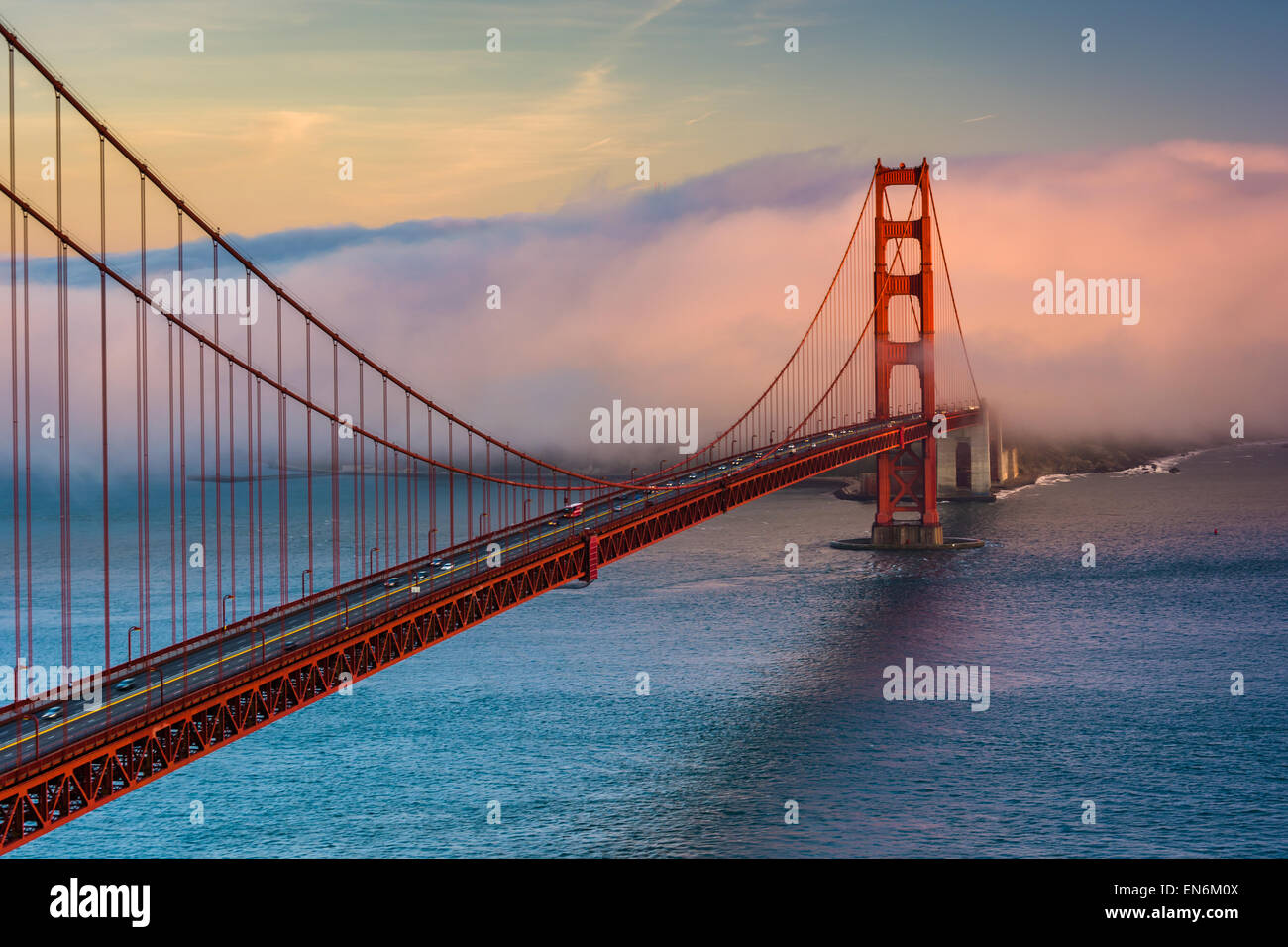 Sunset view of the Golden Gate Bridge and fog from Battery Spencer,  Golden Gate National Recreation Area, in San - Stock Image