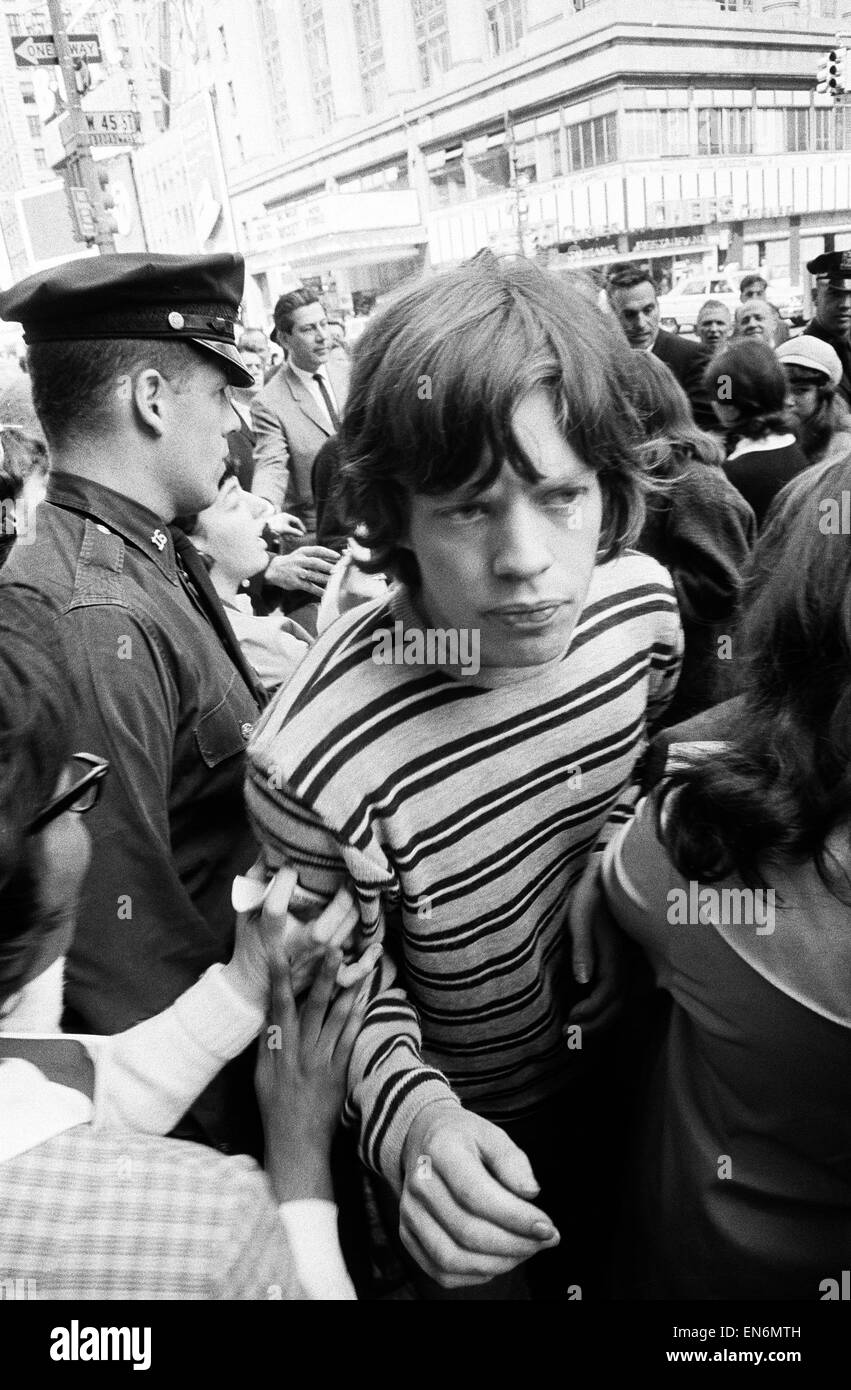 Mick Jagger of The Rolling Stones surrounded by fans on Broadway. 2nd June 1964. - Stock Image