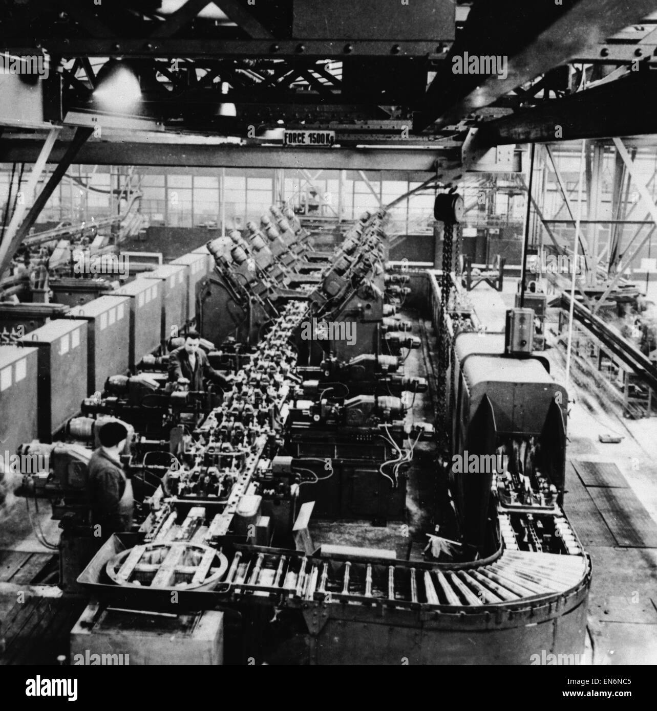 """Picture to accompany the """"Robot Revolution"""" feature which ran in the Daily Mirror newspaper on the week commencing 27th June 1955. Electronic and conveyor belt devices in operation at a British factory. 20th June 1955. Stock Photo"""