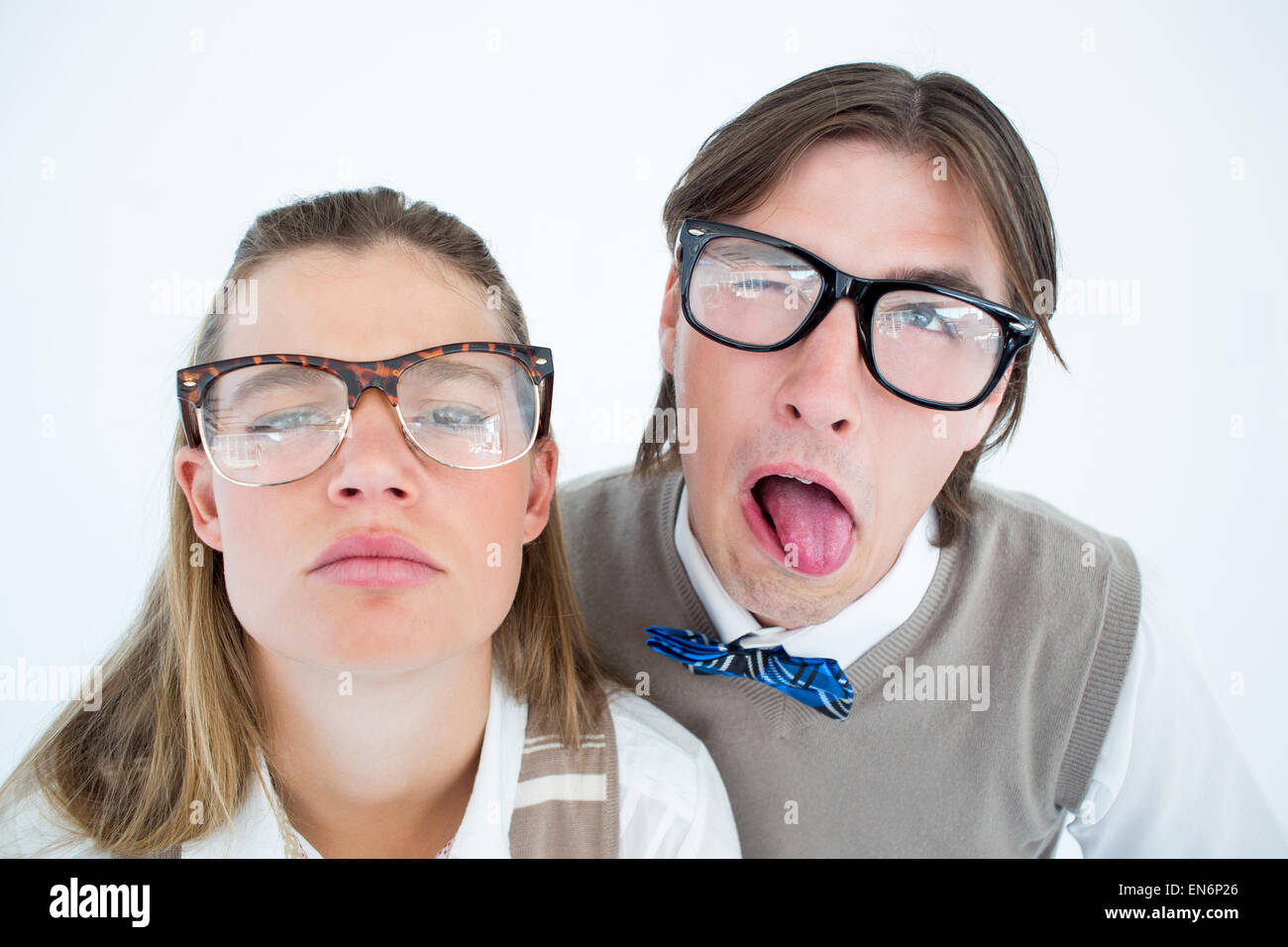 Funny geeky hipsters grimacing Stock Photo