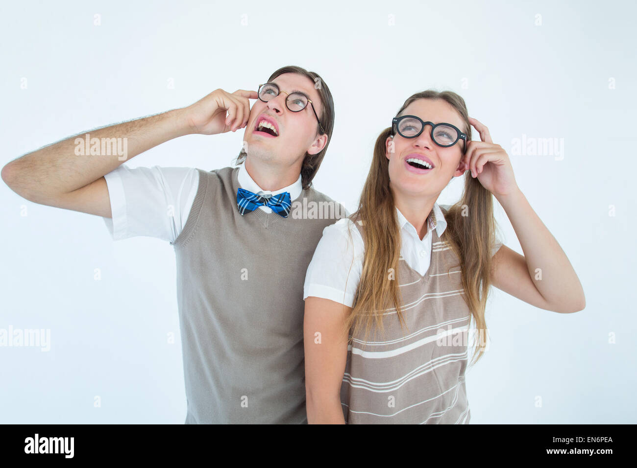 Geeky hipsters looking confused - Stock Image