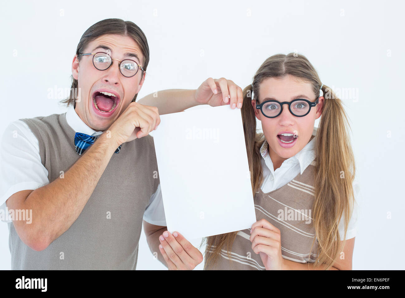 Geeky hipsters holding a poster - Stock Image