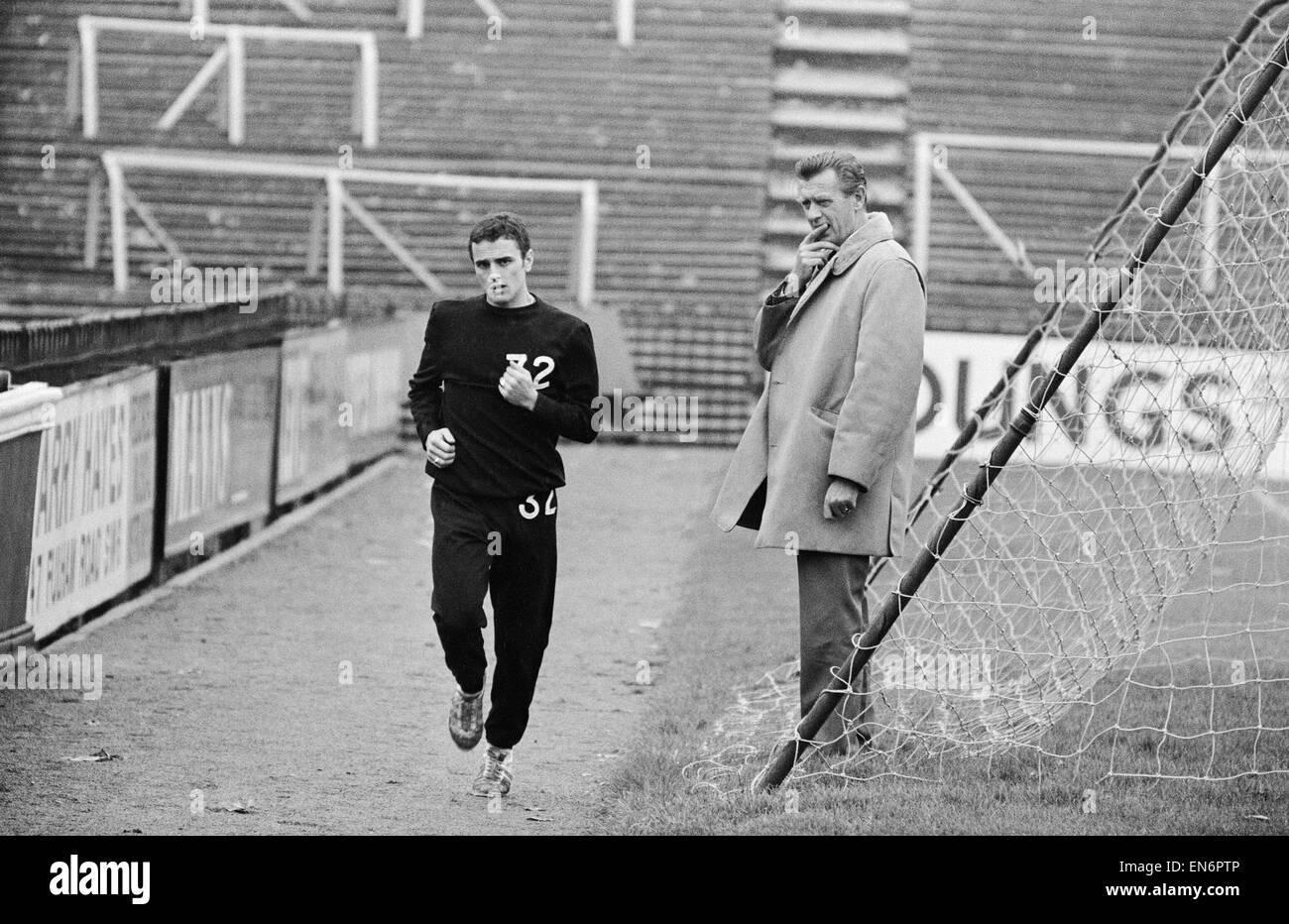 Fulham manager Vic Buckingham watches Steve Earle doing light training. 14th November 1967. - Stock Image