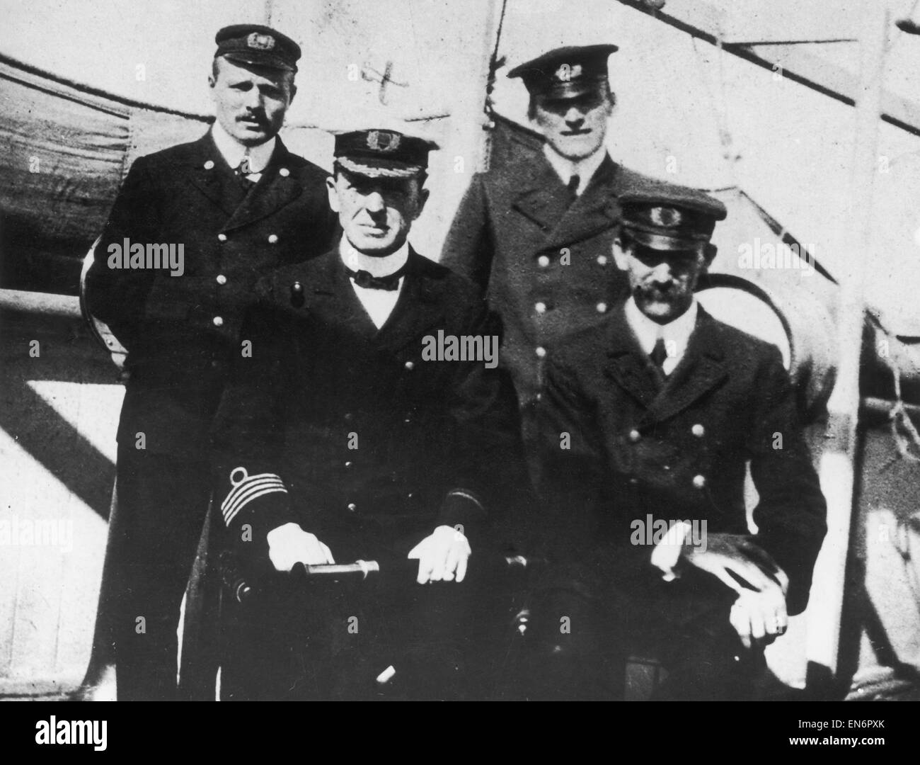 Captain Stanley Lord of the SS Californian (front row holding spy glass) poses with three senior officers. Controversy - Stock Image