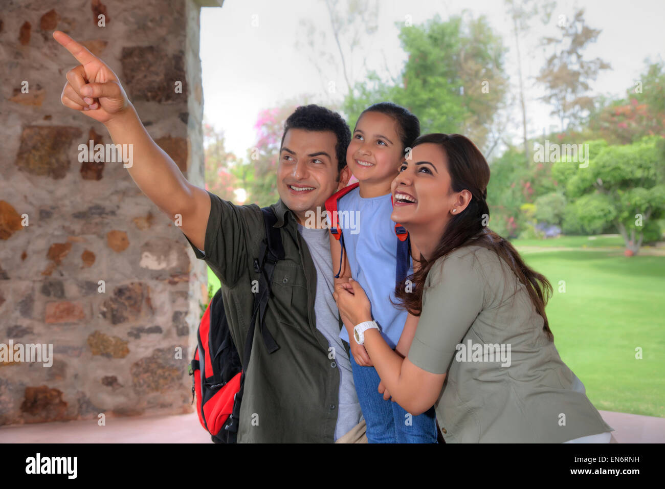 Woman pointing something out to family - Stock Image