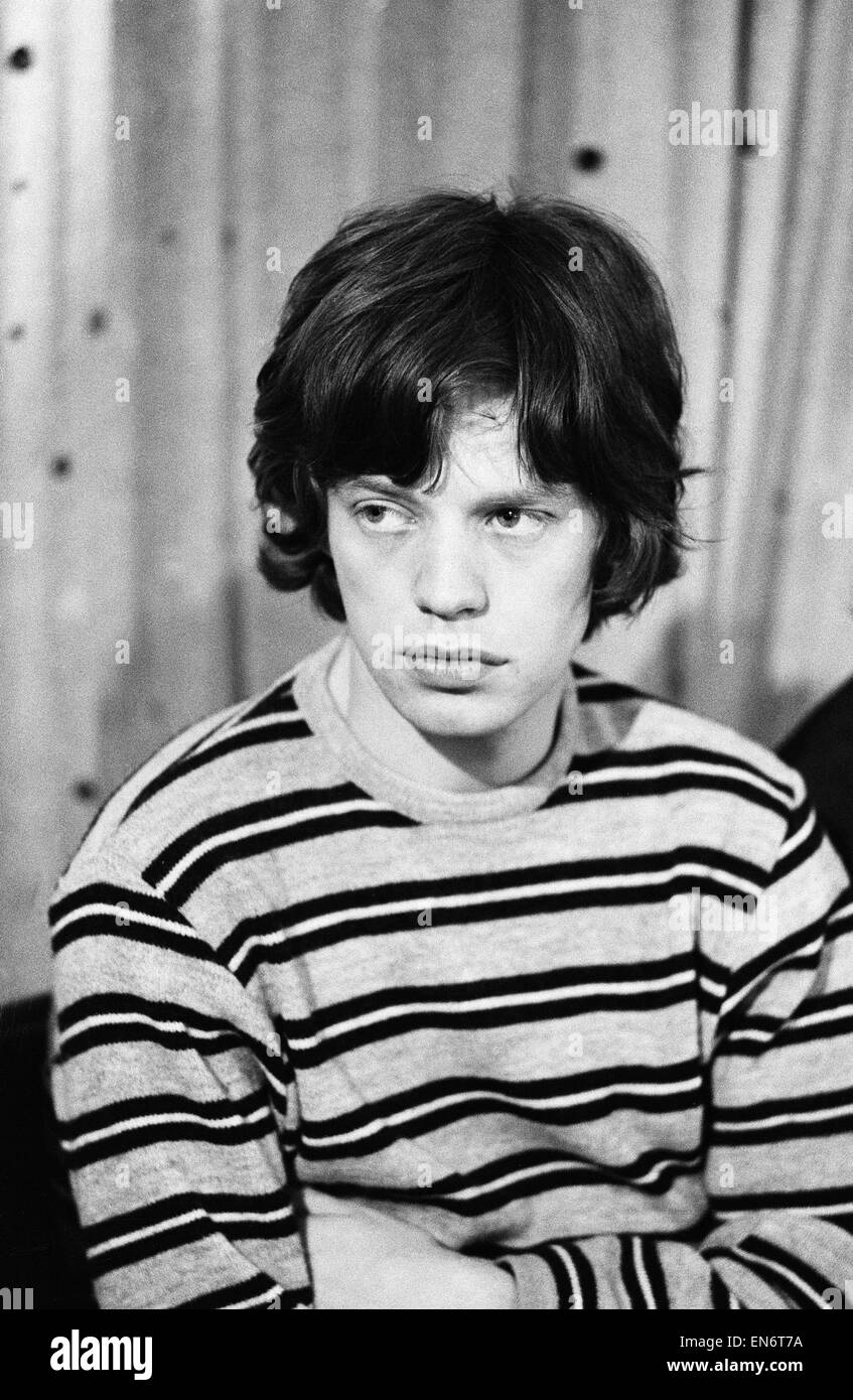 Mick Jagger of The Rolling Stones in the studio after meeting fans on Broadway. 2nd June 1964 - Stock Image