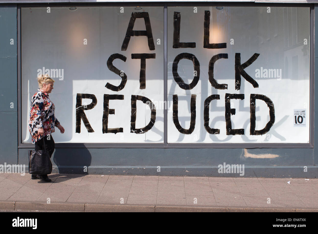 ALL STOCK REDUCED sign on high street shop window where the economic growth shows signs of slowing, Ramsgate, UK - Stock Image