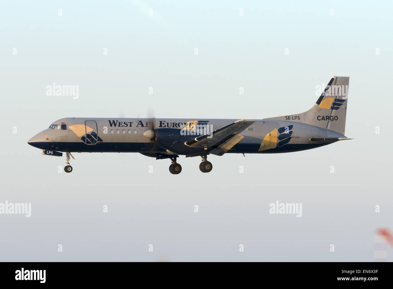 West Air Sweden British Aerospace ATP landing in the last rays of the day. - Stock Image