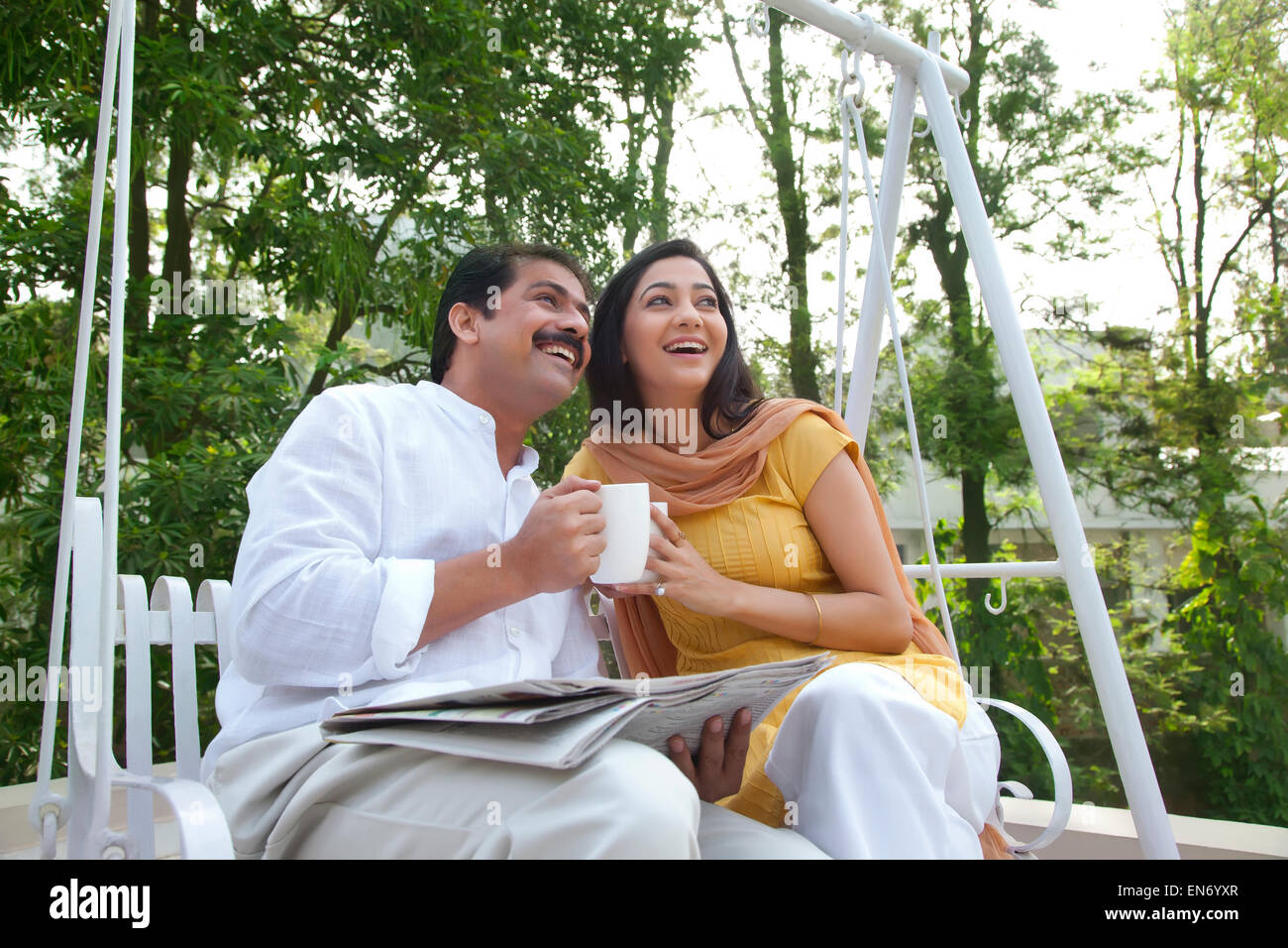 Husband and wife looking at something - Stock Image
