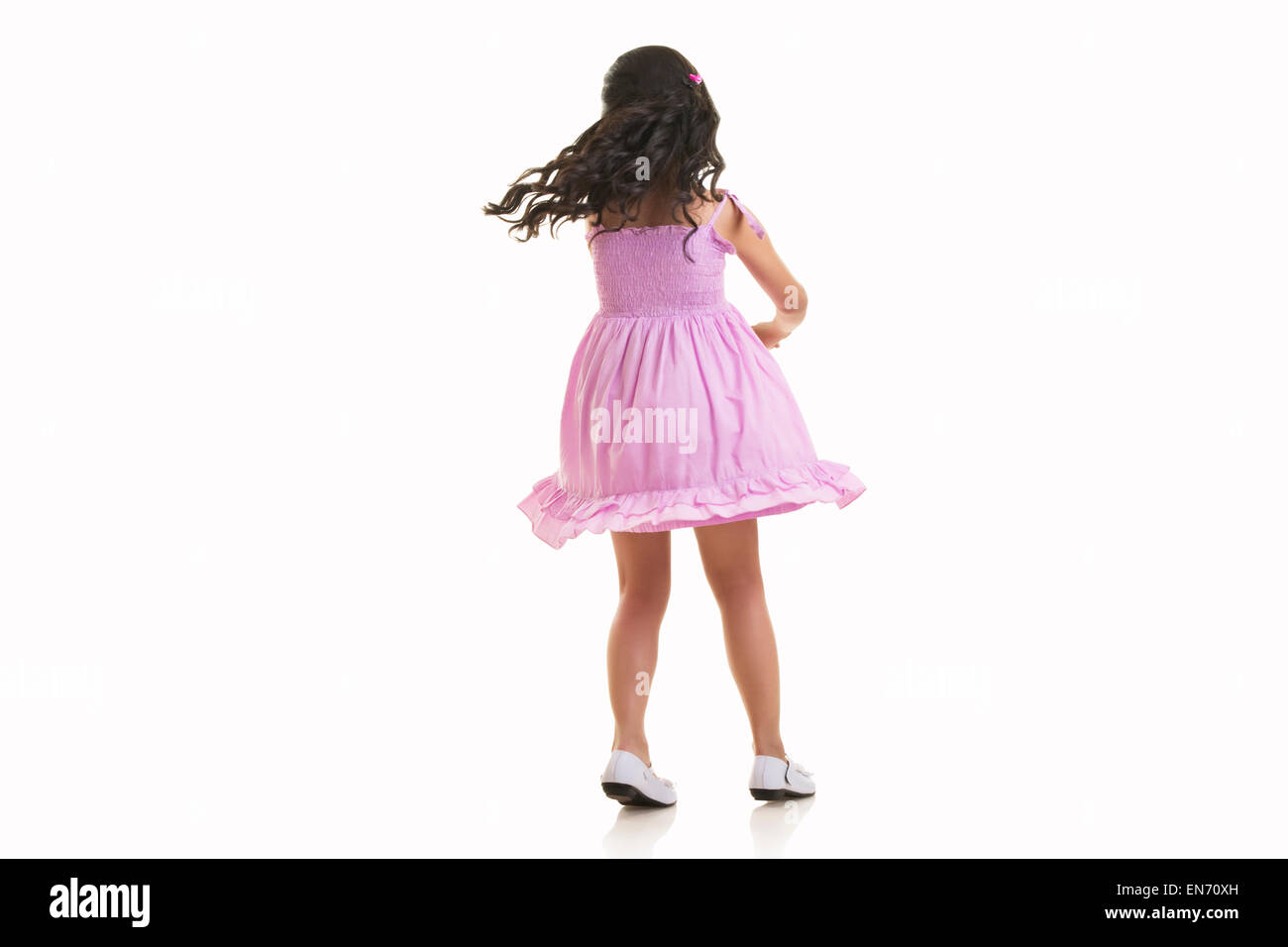 Girl twirling around - Stock Image