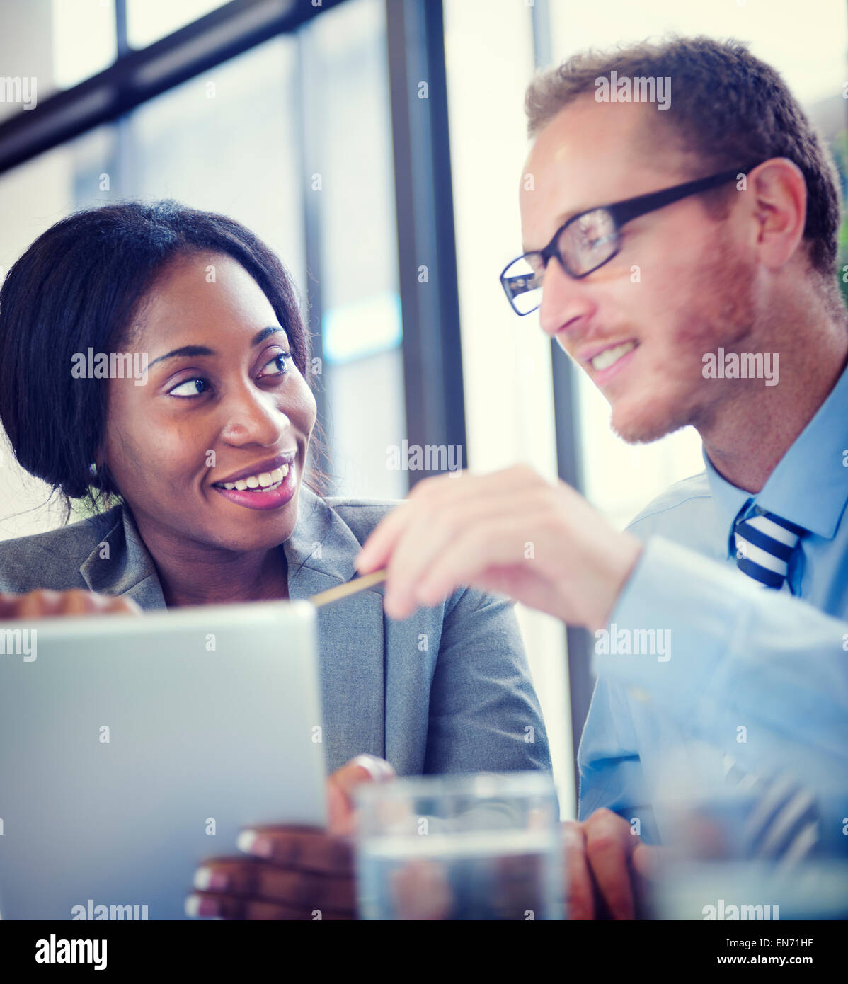 Business Colleagues Discussing in the Office - Stock Image