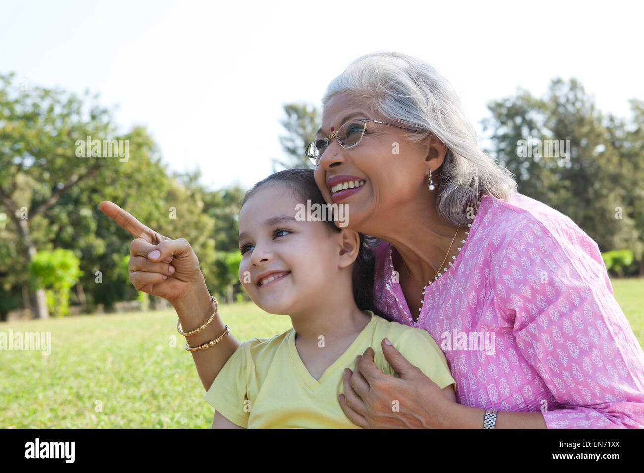 Grandmother pointing something out to granddaughter - Stock Image