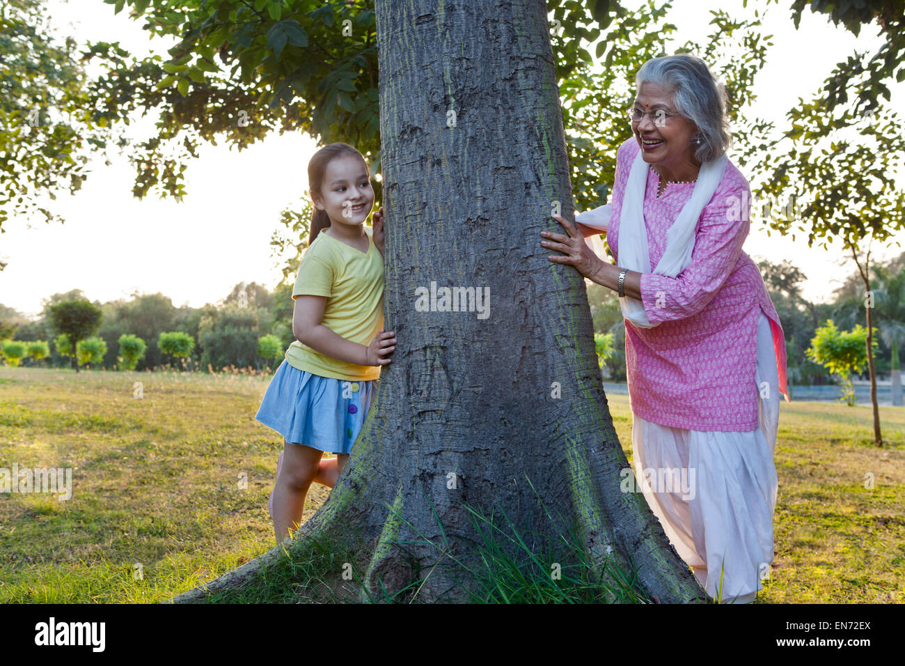 Grandmother and granddaughter playing hide and seek - Stock Image