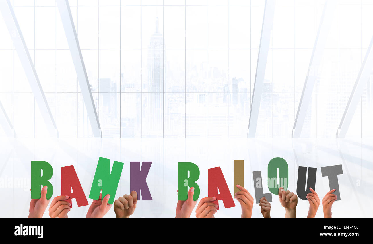 Composite image of hands holding up bank bailout - Stock Image
