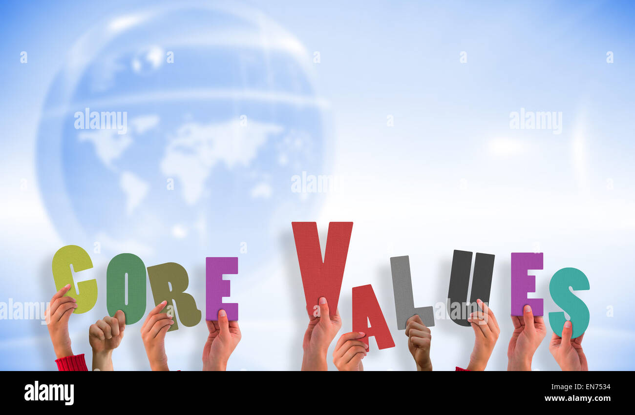 Composite image of hands holding up core values - Stock Image