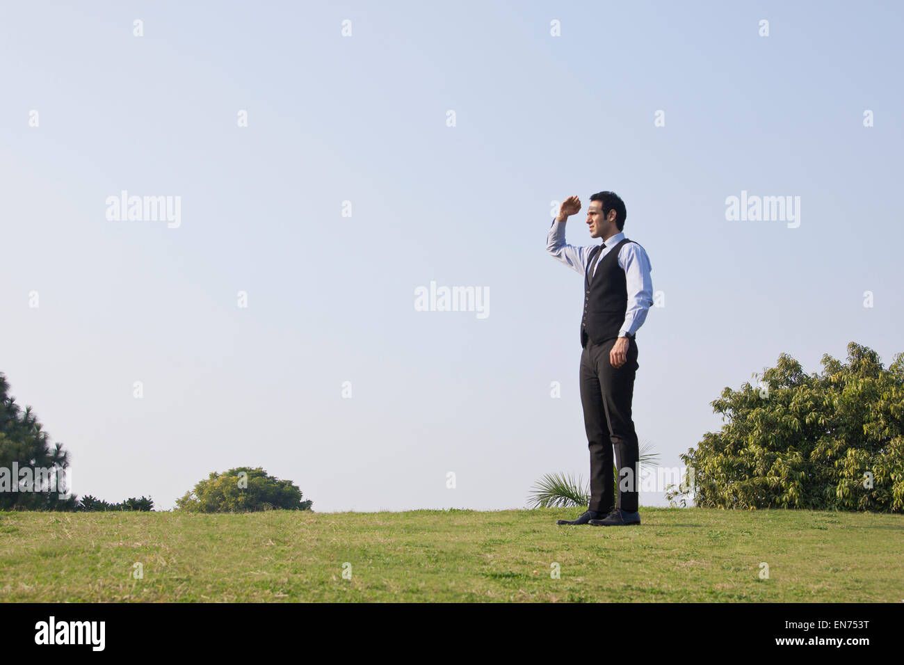 Businessman looking at something , INDIA , DELHI - Stock Image