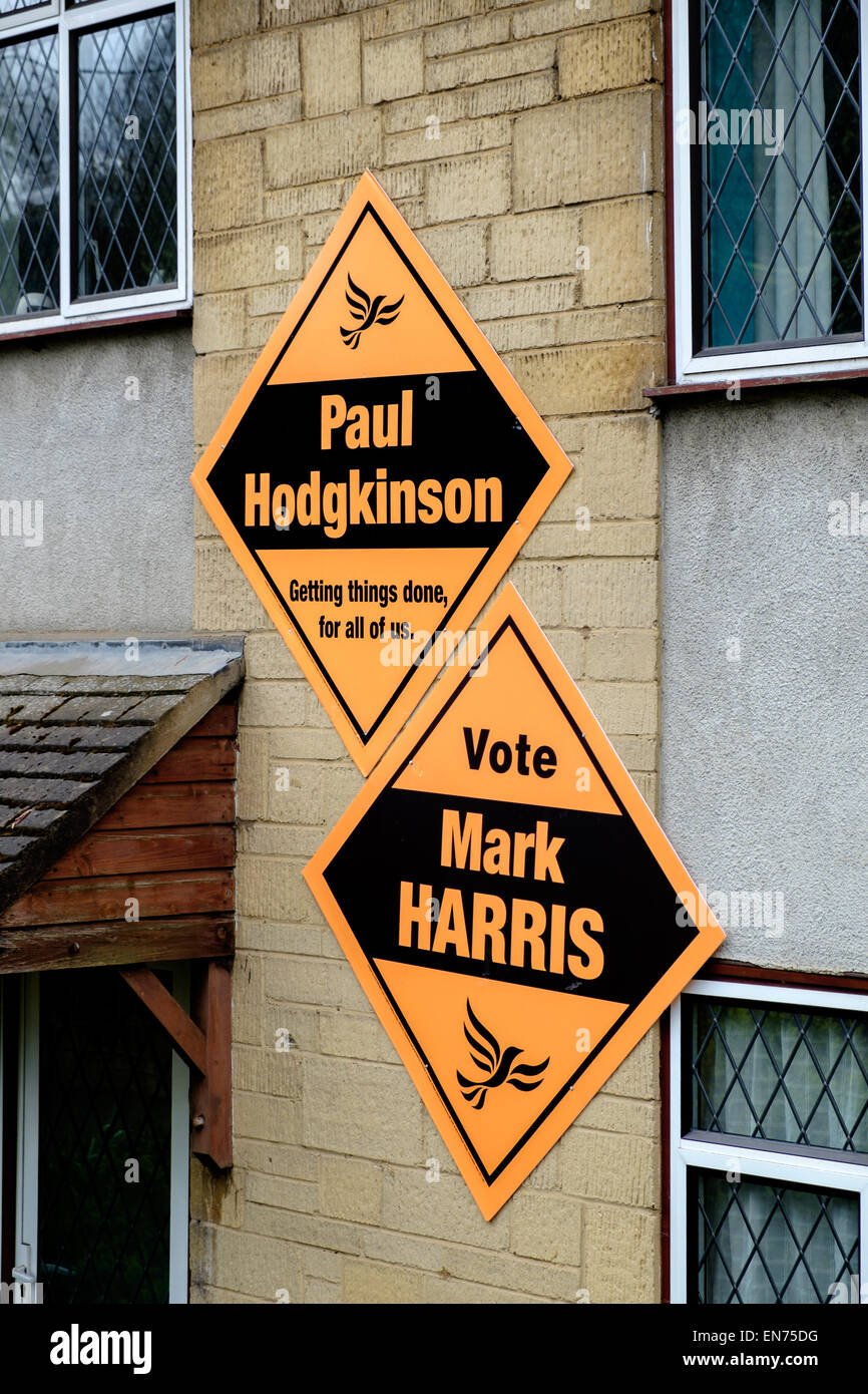 Two Liberal Democrat banners signs on the exterior wall of a house in Cirencester UK general election candidates - Stock Image