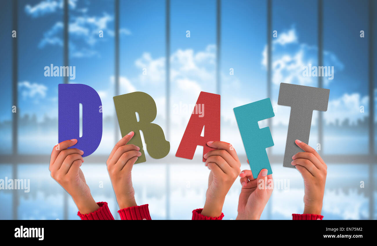 Composite image of hands holding up draft - Stock Image