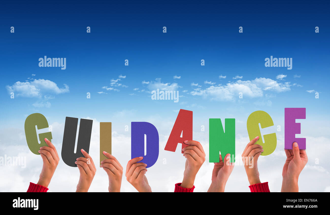 Composite image of hands holding up guidance - Stock Image