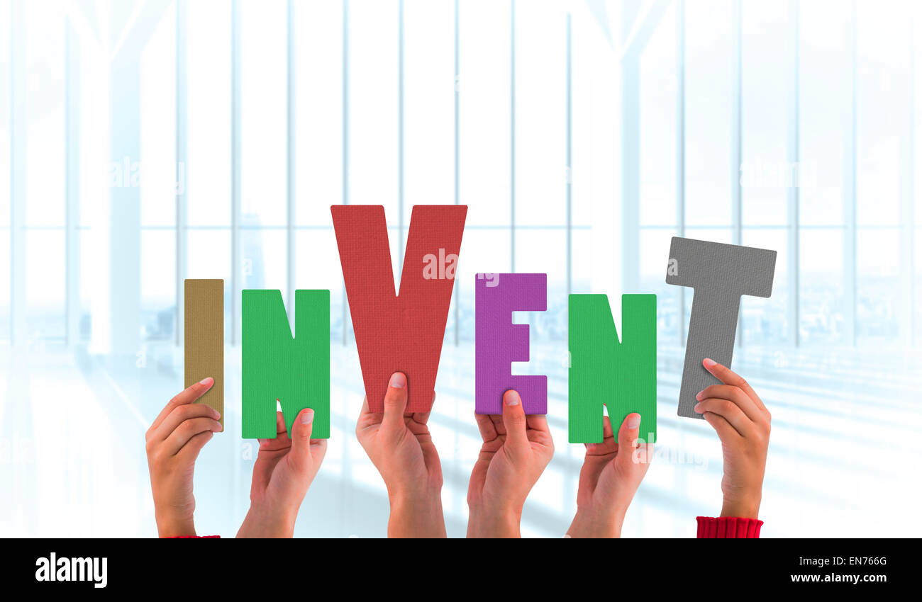 Composite image of hands holding up invent - Stock Image