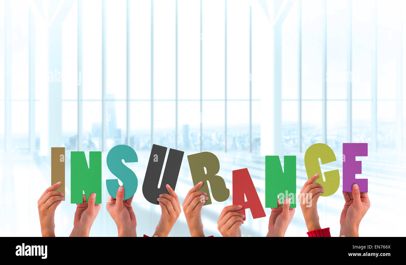 Composite image of hands holding up insurance - Stock Image
