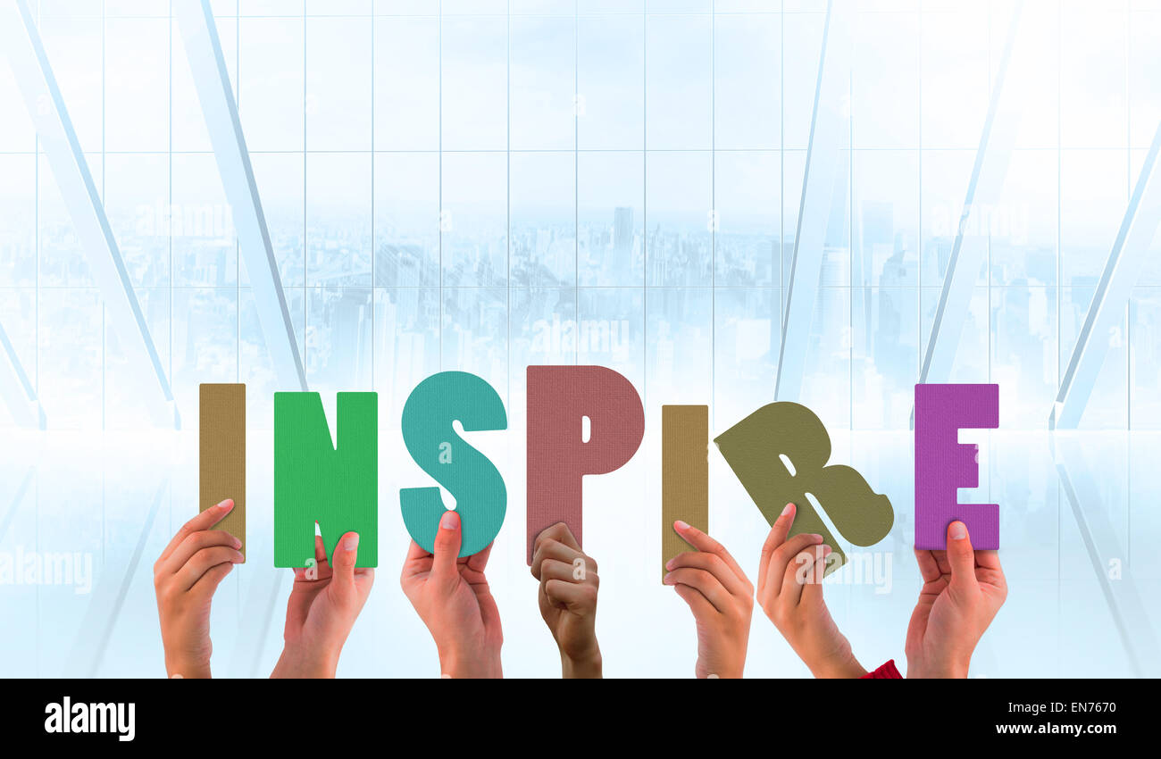 Composite image of hands holding up inspire - Stock Image