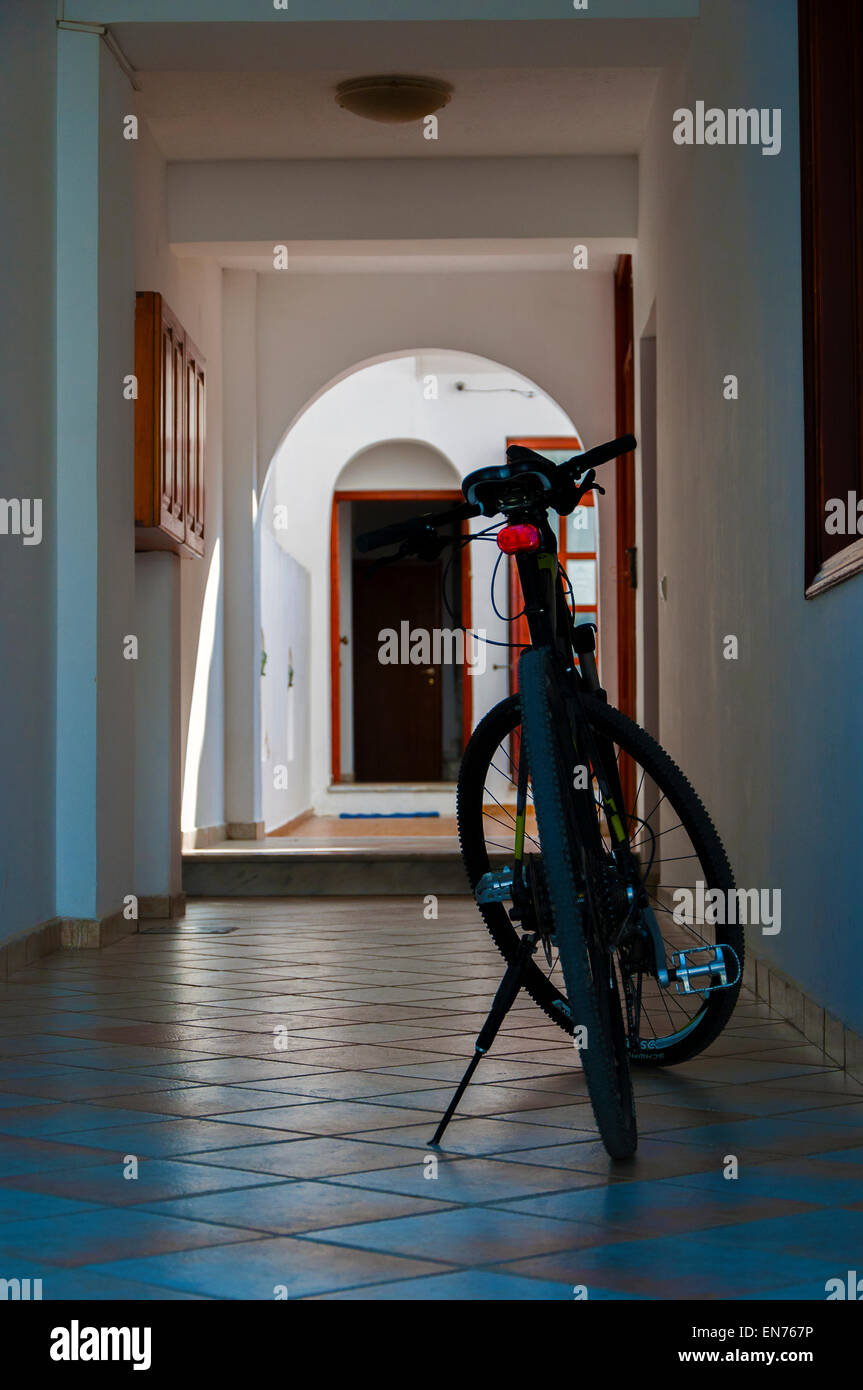Bicycle in passageway. - Stock Image
