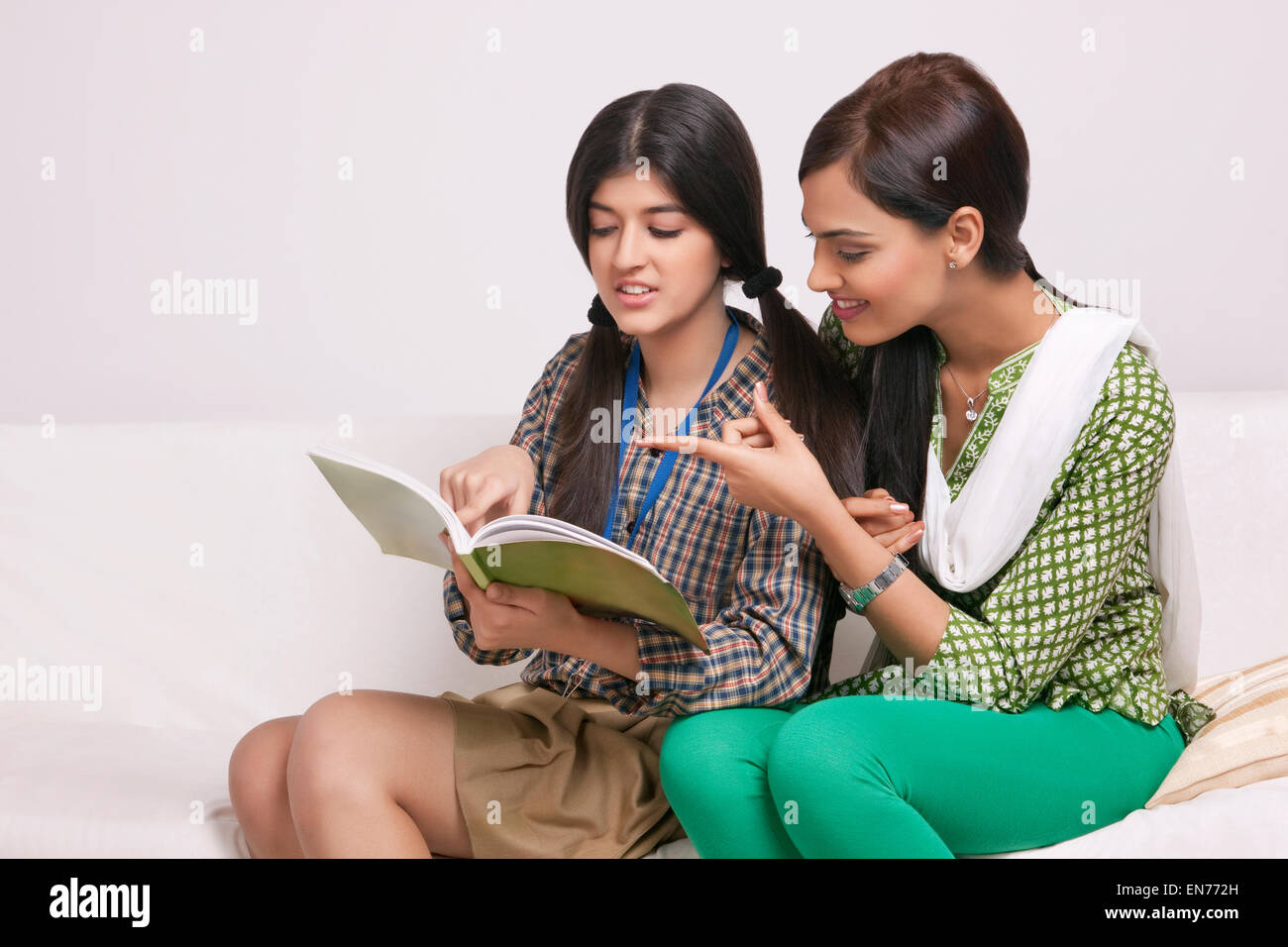 Elder sister teaching younger sister - Stock Image